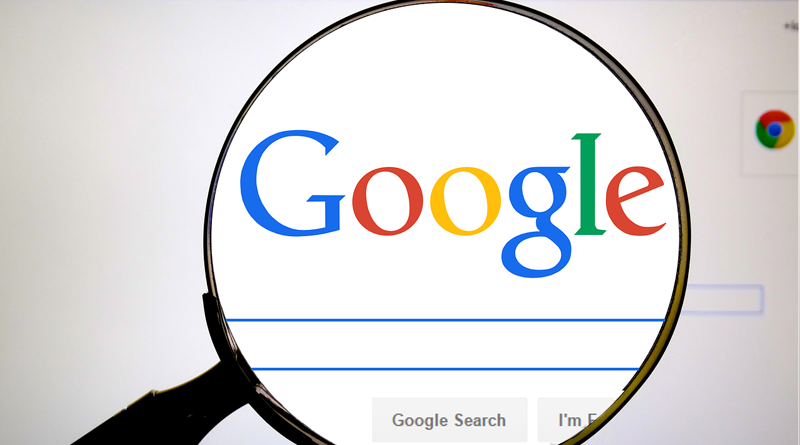 magnifying glass over google